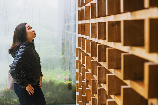 Side View Of Woman Looking Up - gettyimageskorea