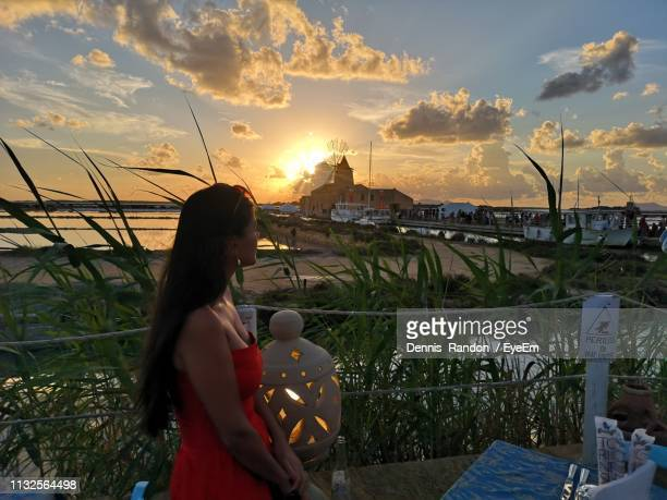 side view of woman standing against sky during sunset - marsala sicily stock pictures, royalty-free photos & images