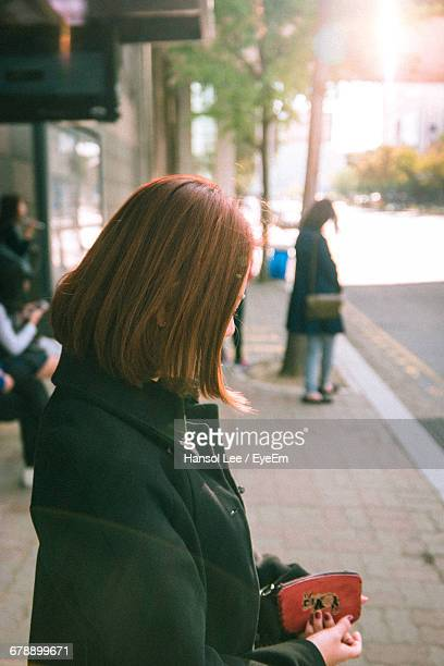 Side View Of Woman Standing Outdoors In The City
