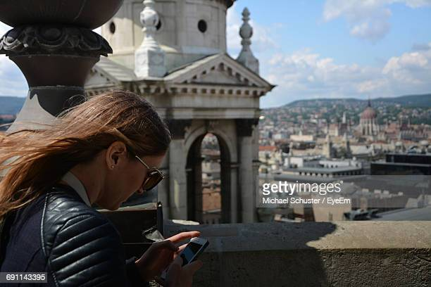Side View Of Woman Using Mobile In Balcony At St Stephen Basilica