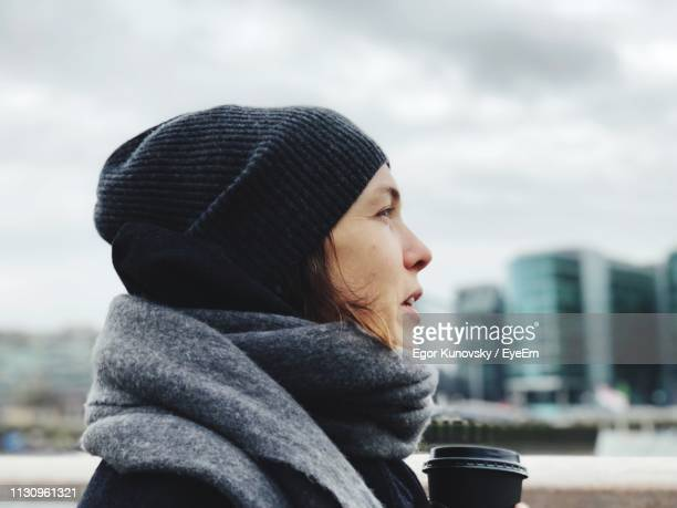 side view of woman wearing warm clothing during winter - cold temperature stock pictures, royalty-free photos & images