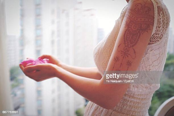 Side View Of Woman With Henna Tattoo On Hand