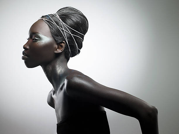 Side view of woman with metallic make up