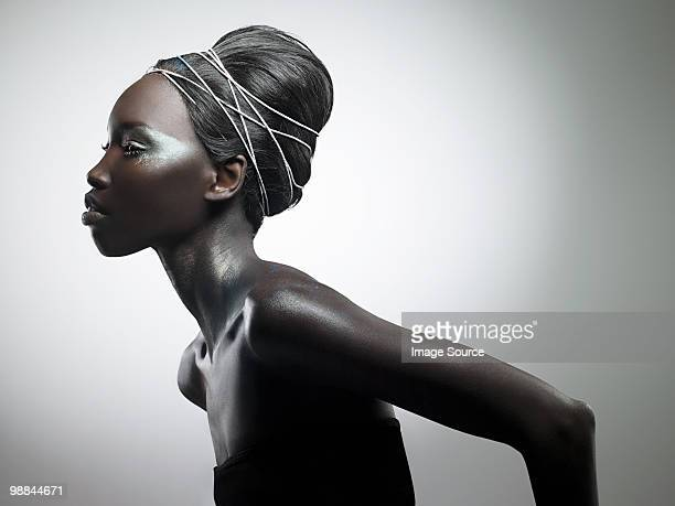 side view of woman with metallic make up - fashion stock pictures, royalty-free photos & images