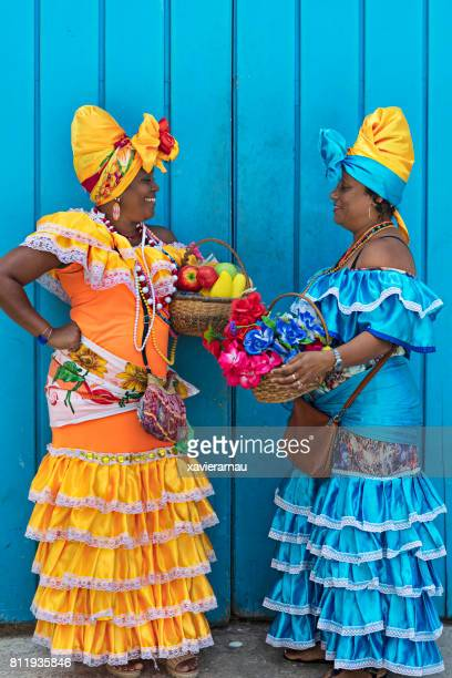 Side view of women in Cuban traditional dresses