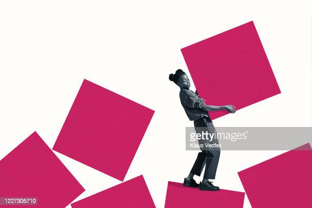 side view of young woman carrying large pink block - dismantling stock pictures, royalty-free photos & images