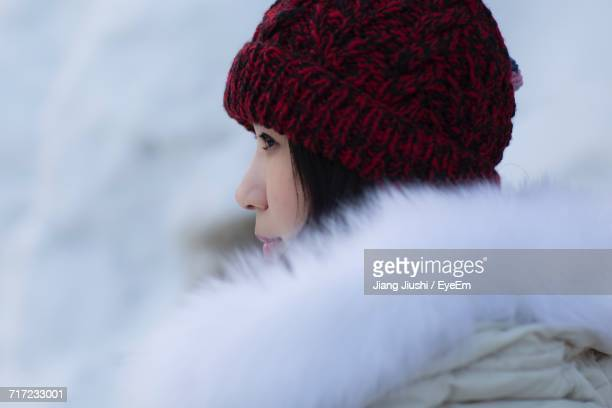 Side View Of Young Woman In Snow