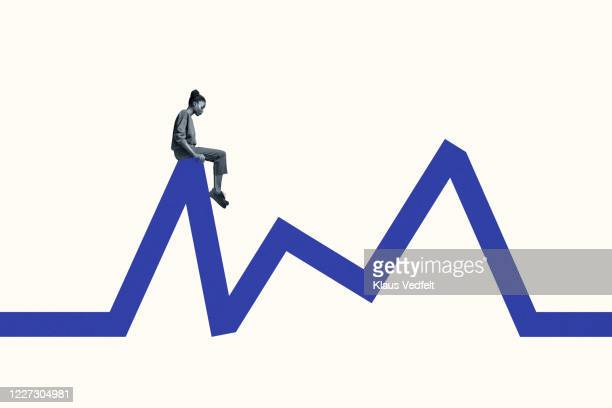 side view of young woman sitting blue line graph - data stock pictures, royalty-free photos & images