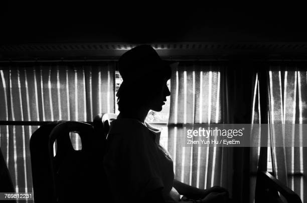 side view of young woman sitting in bus - changzhou stock pictures, royalty-free photos & images