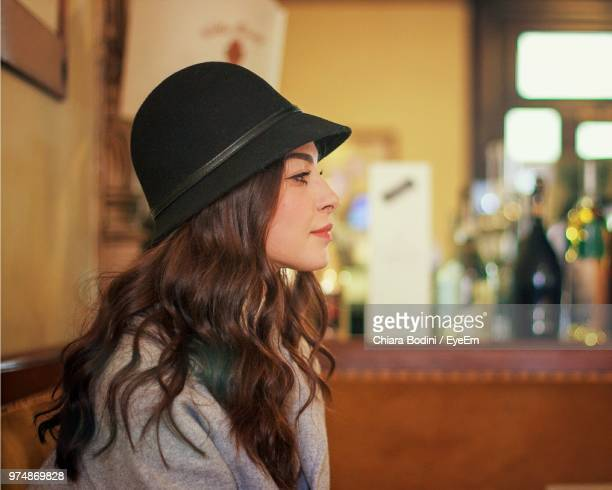 Side View Of Young Woman Wearing Hat
