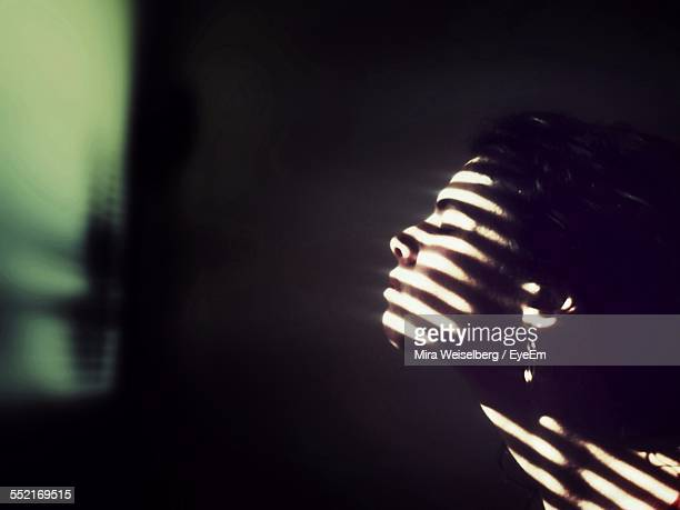 Side View Of Young Woman With Shadow On Face