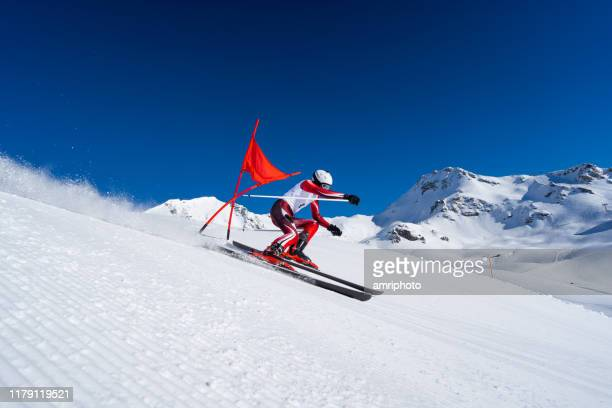 side view professional skier skiing super g perfect weather conditions - ski racing stock pictures, royalty-free photos & images
