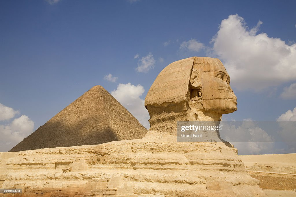 side view sphinx and pyramid : Stock Photo