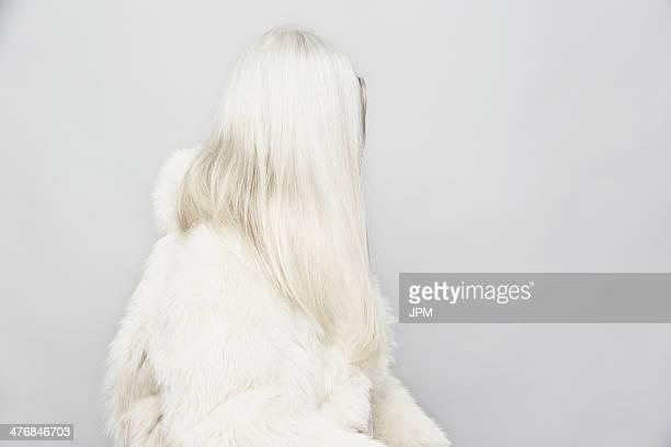 side view studio portrait of senior woman with long grey hair - hairy woman stock-fotos und bilder