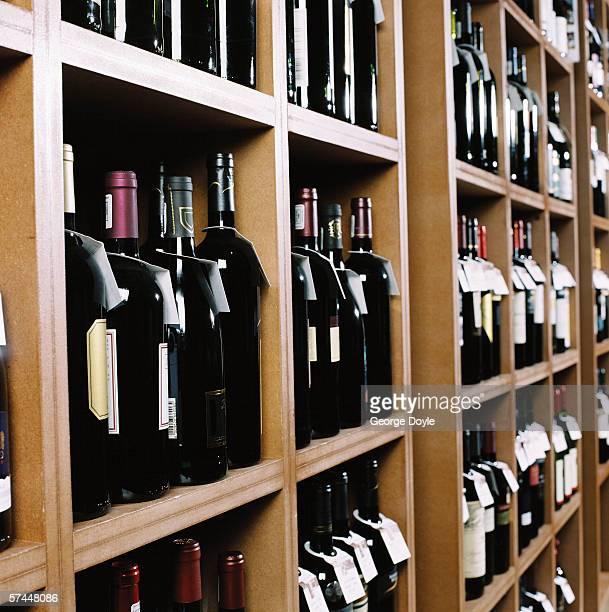 side view wine bottles kept on display in shelves