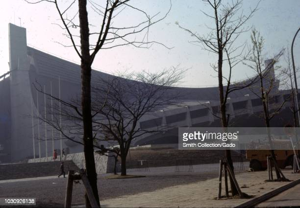 Side view with architectural details and public square with trees at Yoyogi National Stadium Tokyo Japan 1963