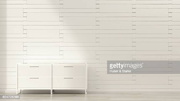 sideboard in front of modern wall
