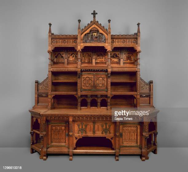 Sideboard, known as The Pericles Dressoir British, London, Oak, inlaid with ebony, walnut, boxwood, amaranth, carved and gilded; brass fittings,...
