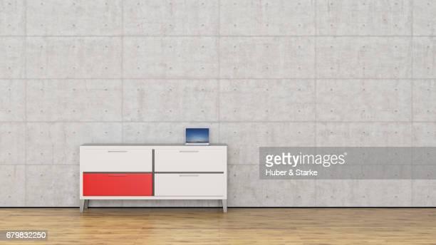sideboard with laptop in front of concrete wall - wohnraum bildbanksfoton och bilder