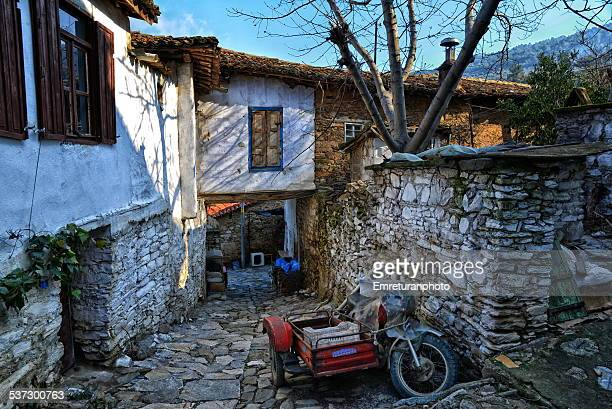 Sidecar bike and passage under a house