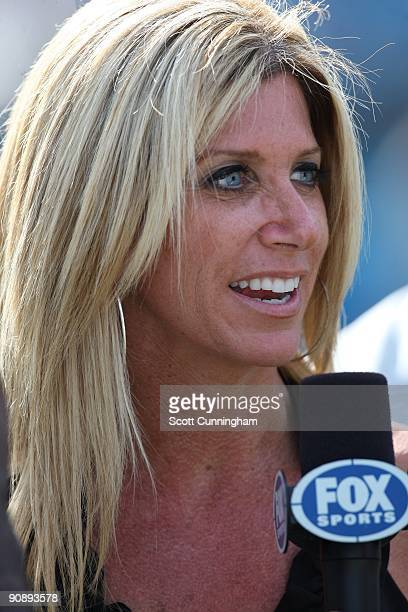Sideline announcer Laura Okmin gives a report during the game between the Carolina Panthers and the Philadelphia Eagles at Bank Of America Stadium on...