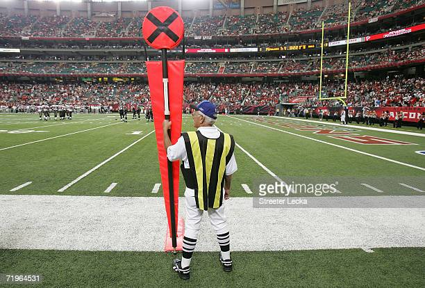 A sideline official holds a yard marker as the Atlanta Falcons host the Tampa Bay Buccaneers during their game on September 17 2006 at the Georgia...