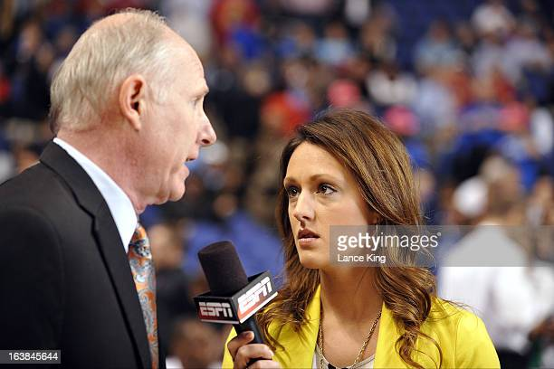 ESPN sideline reporter Allison Williams interviews Head Coach Jim Larranaga of the Miami Hurricanes during halftime of a game against the Boston...