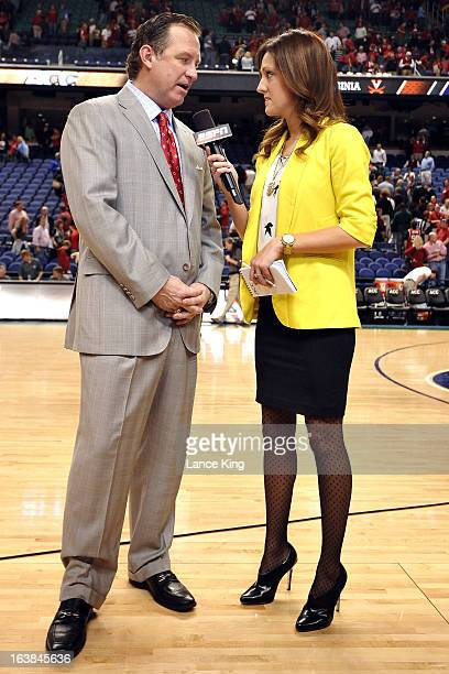 ESPN sideline reporter Allison Williams interviews Head Coach Mark Gottfried of the North Carolina State Wolfpack following a game against the...