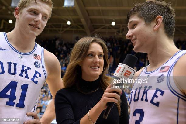 ESPN sideline reporter Allison Williams interviews Jack White and Grayson Allen of the Duke Blue Devils following their game against the Notre Dame...