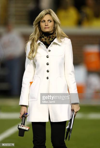 ESPN sideline reporter Erin Andrews walks across the field during pregame warmups before the game between the Georgia Tech Yellow Jackets and the...