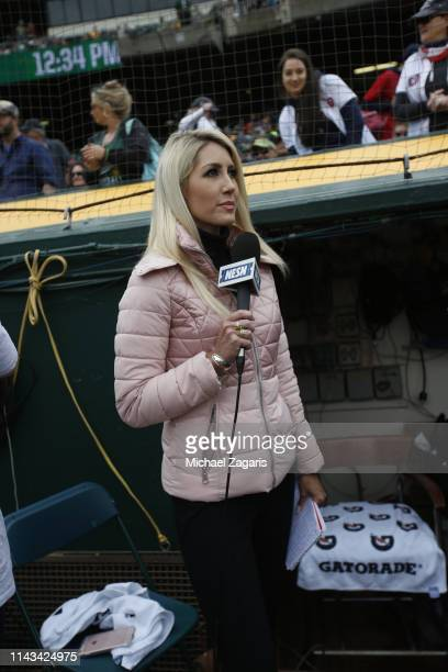 Sideline Reporter Guerin Austin of NESN reports from the field prior to the game between Boston Red Sox and the Oakland Athletics at the...