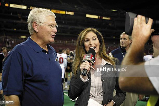ABC sideline reporter Lisa Guerrero interviews head coach Mike Martz of the St Louis Rams following their victory over the Tampa Bay Buccaneers in...