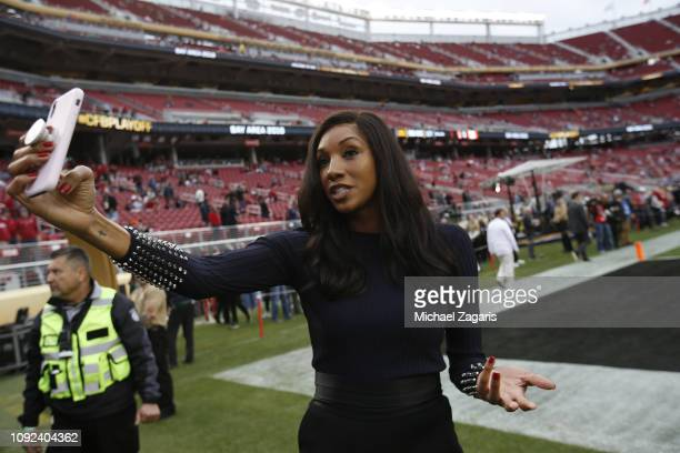 ESPN sideline reporter Maria Taylor takes a selfie on the field prior to the game between the Clemson Tigers and the Alabama Crimson Tide in the CFP...