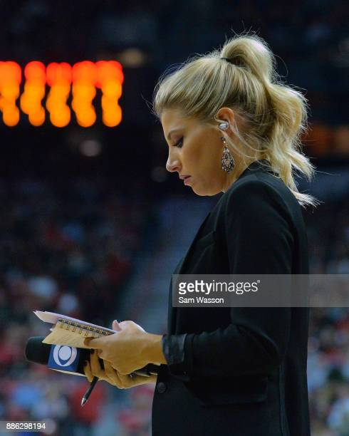 Sideline reporter Melanie Collins studies her notes during a game between the Arizona Wildcats and the UNLV Rebels at the Thomas Mack Center on...
