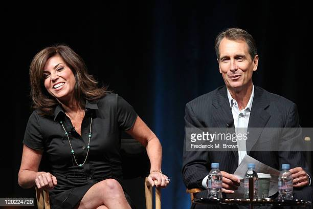 Sideline Reporter Michele Tafoya and Game Analyst Chris Collinsworth speak during the 'Sunday Night Football' and 'Super Bowl XLVI' panel during the...