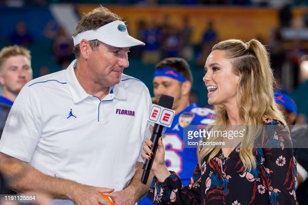 ESPN sideline reporter Molly McGrath interviews Florida Gators head coach Dan Mullen after the College Football game between the Florida Gators and...