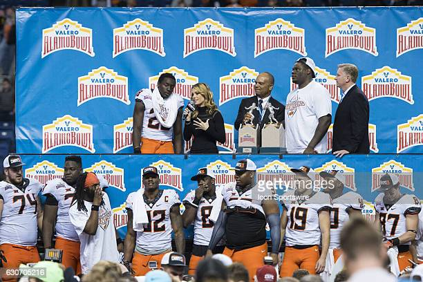 ESPN sideline reporter Molly McGrath talks with Oklahoma State Cowboys wide receiver James Washington after the Valero Alamo Bowl between the...