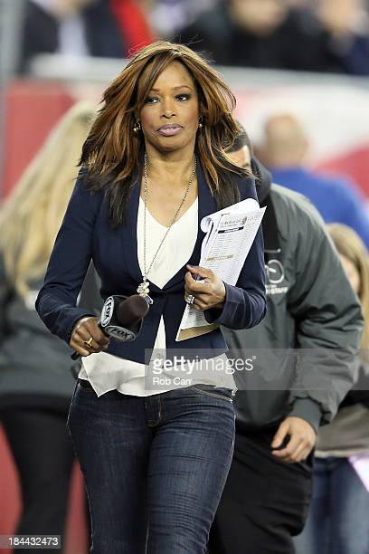 Sideline reporter Pam Oliver walks the sideline during the New England Patriots and New Orleans Saints game at Gillette Stadium on October 13 2013 in...