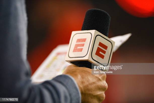 ESPN sideline reporter Paul Carcaterra holding a mic during a college football game between the University of Central Florida Knights and Cincinnati...