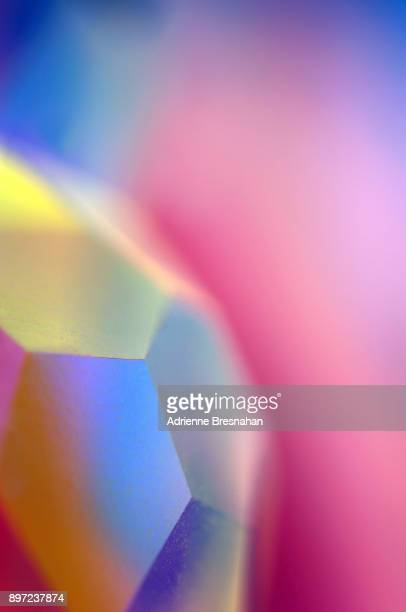 sides of a faceted crystal prism, close-up - precious gemstone stock pictures, royalty-free photos & images