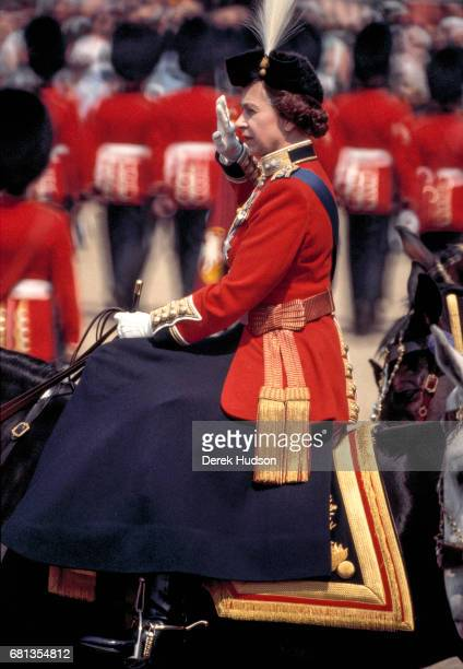 Sidesaddle on her horse Burmese Queen Elizabeth II salutes during the Trooping the Colour ceremony at Horse Guards Parade London England mid 1980s