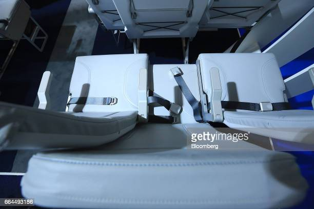 Side-slip passenger seats sit on display in the Molon Labe Designs pavilion at the Aircraft Interiors Expo in Hamburg, Germany, on Tuesday, April 4,...