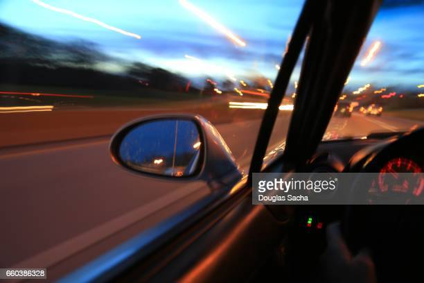 sideview mirror on a moving car - dashboard camera point of view stock photos and pictures