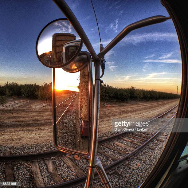 side-view mirror on semi-truck against sky during sunset - side view mirror stock photos and pictures