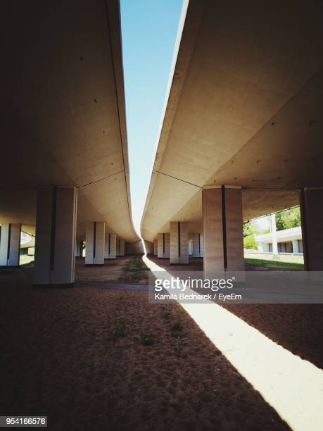 sidewalk against sky - colonnade stock pictures, royalty-free photos & images