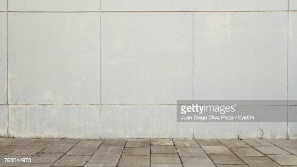 sidewalk amidst wall - sidewalk stock pictures, royalty-free photos & images