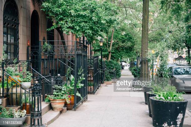 sidewalk and residential houses in murray hill district in manhattan, new york city - sidewalk stock pictures, royalty-free photos & images