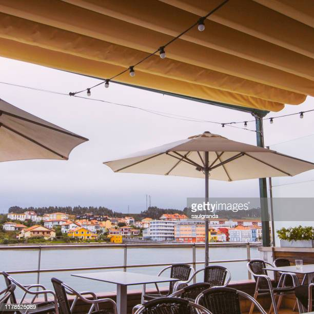 sidewalk cafe against the coast - sunshade stock pictures, royalty-free photos & images