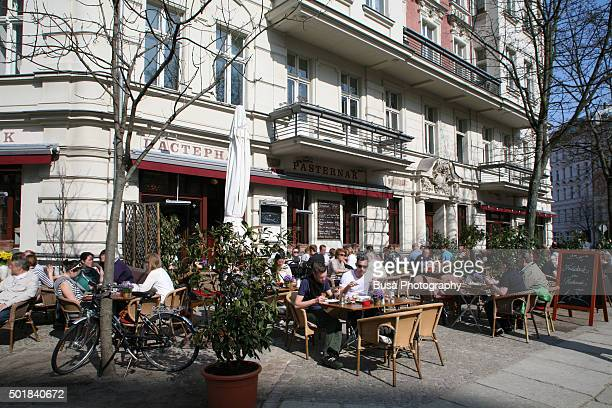 Sidewalk cafe in the streets of Berlin, district of Prenzaluerberg