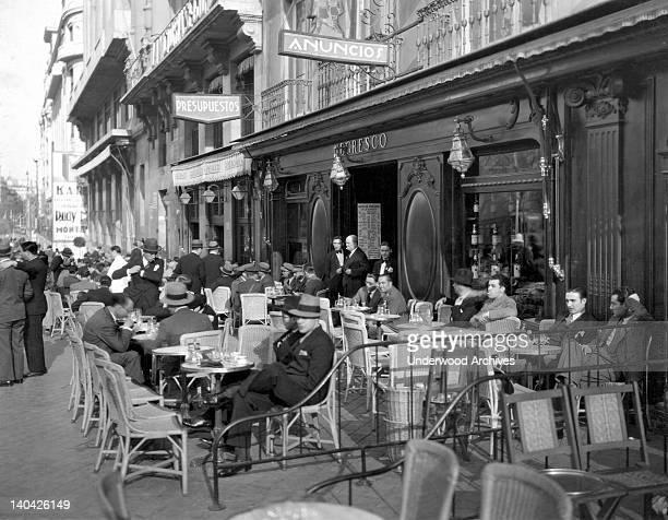 A sidewalk cafe on Calle Acala in Madrid Spain circa 1926